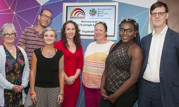 Picture shows Maria Onasanya (second right) and Rachel Taylor (third right) with researchers from the Brightlight study on cancer in young people and a patient representative.