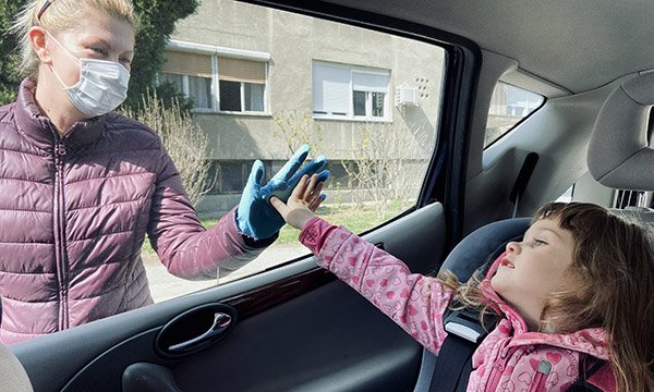 Picture shows a child in a car touching the window and a woman outside the car touching it from the other side.  A mental health charity has seen a jump in calls for help from nurses whose well-being is affected by pressure of choices they have to make.
