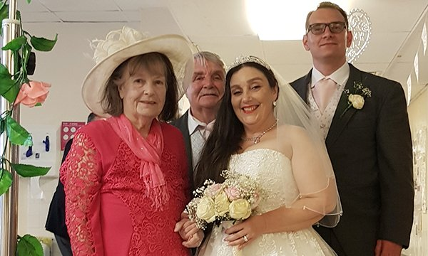 Ms Adams on the ward with her husband Arthur and daughter and son-in-law on their wedding day