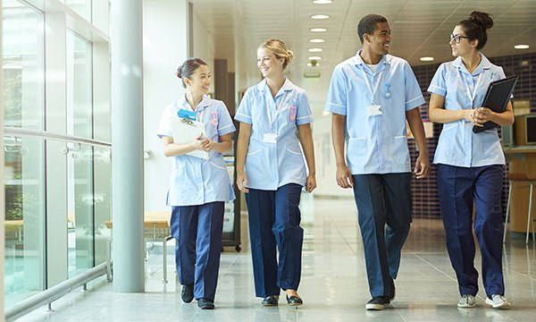Four nursing students in a hospital during placement. UCAS data also show record numbers of people accepting a place to study nursing in England