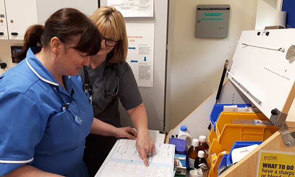 Emma Robinson, left, a nurse on the out of practice programme, and advanced clinical practitioner Helen Lushpenko-Brown, checking patient medications