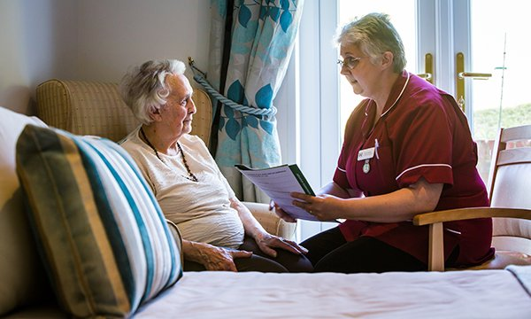 Care planning: a nurse outlining options for a patient in a hospice