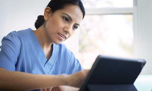 Senior nurse communicating via a laptop. Picture: iStock