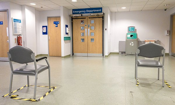 Socially distanced chairs in an emergency department Picture: Alamy