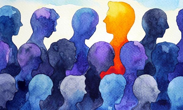Abstract image of showing a group of people's heads, al in blue, with one in yellow standing out and facing in the opposite direction