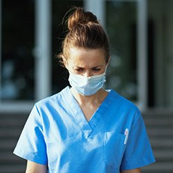 A nurse wearing a face mask at work
