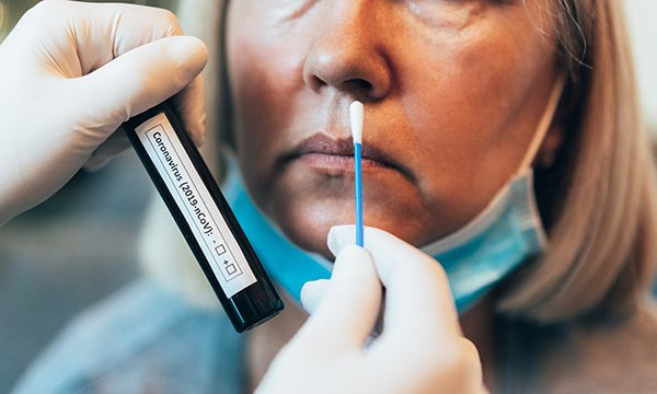 Woman being swab-tested for coronavirus