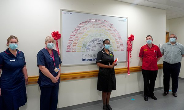 Intensive care unit nurse Laura Kirby-Deacon (second from left) at the unveiling of the mural she created at Great Western Hospitals NHS Foundation Trust in Swindon