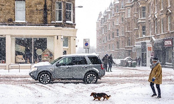 A 4x4 car in snowy weather. NHS trusts have revealed emergency travel plans for staff this winter