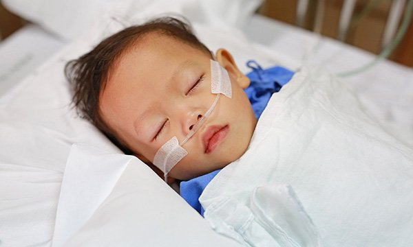 Sick child in hospital bed