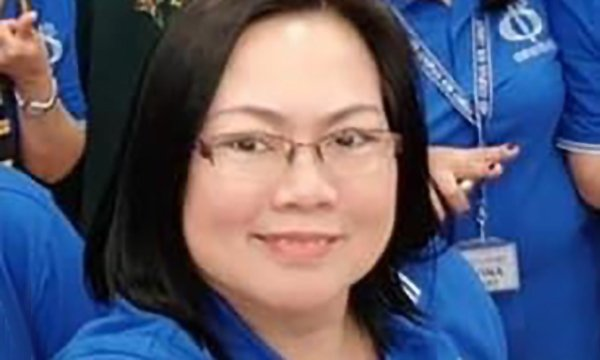 Picture shows Ana Lisa Labrador Sayson in her nurse's uniform