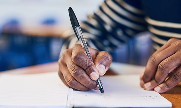 Image of someone writing in a journal, which can help ease distress and anxiety