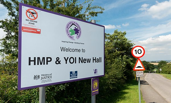 Sign showing the entrance to HMP and YOI New Hall in West Yorkshire