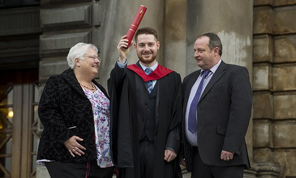 Sarah Chalmers, Fraser Chalmers and Ross Chalmers at Fraser's graduation at Edinburgh Napier University on October 27
