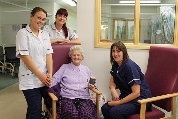 Patient Joan Riley enjoys a cuppa in the discharge suite. Pictured with discharge facilitator team lead Linda Smith and care support workers Jennifer McLaren and Leanne Morrissey.