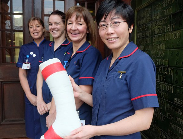 Warrington and Halton Hospitals nurses Rachael Browning, Grace Delaney-Segar, Heather Aston and Xiurong Deng with a red banded plaster cast