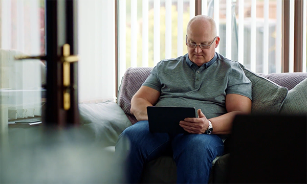 Picture shows an older man checking the results of his prostate-specific antigen test online as part of the supported self-management programme. New care pathways are easing the strain on prostate cancer services and could be applicable to other types of cancer.