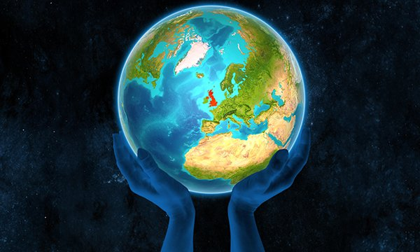 A model globe held by a pair of hands with the UK marked in red. The RCN wants nurses to lobby healthcare providers for strategies on environmental sustainability and raise awareness of climate change.
