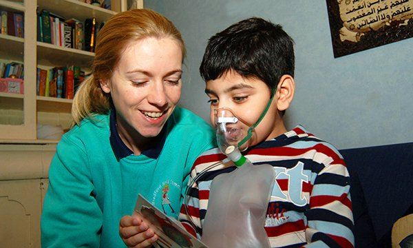 Picture shows a woman with a child wearing an oxygen mask. WellChild gives guidance for families caring for children with complex needs, managing care in the home and for health professionals working with children, including safeguarding advice.