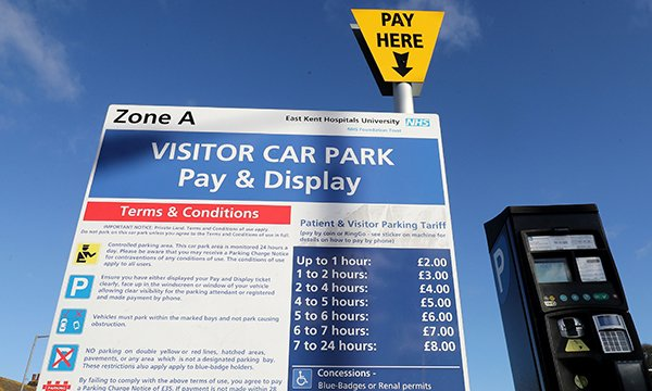 A sign displaying parking charges at Buckland Hospital in Dover, Kent. Hospital car parking charges will be waived for nurses and other NHS staff on night shifts and some patients and parents of sick children.