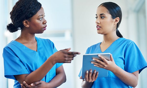 Picture shows two young women in scrubs frowning during a conversation. Being on the receiving end of incivility is always unpleasant but in a healthcare setting it can be dangerous.