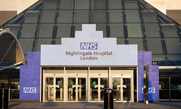 Picture shows entrance to London Nightingale hospital. Article is a nurse's account of a shift at the critical care temporary hospital, which is now on standby