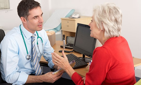 Picture shows a GP consultation. A study suggests that most women in their sixties in England ignore at least one of the three types of cancer screening offered to them.