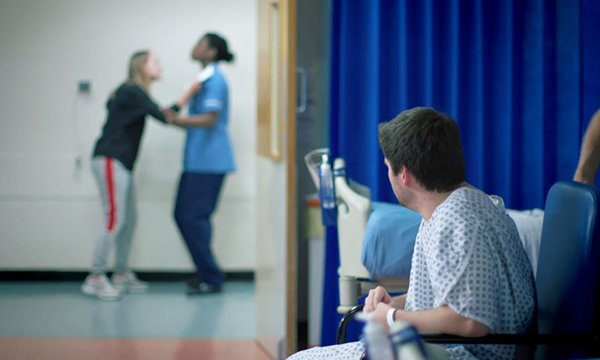 An image from the Barts Health NHS Trust film for its healthcare staff on workplace violence, showing a patient aggressively confronting a staff member
