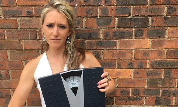 Picture shows Hope Virgo holding a set of scales. She says in this article that healthcare professionals can help challenge the stigma around eating disorders and take opportunities to prevent illness from escalating.