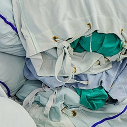 Picture shows bags of items waiting to be washed in a hospital laundry