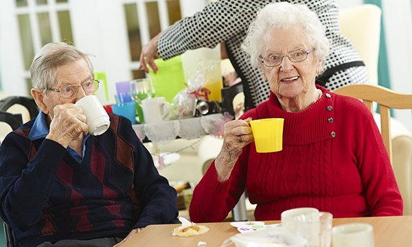 Nursing home residents enjoying a cup of tea