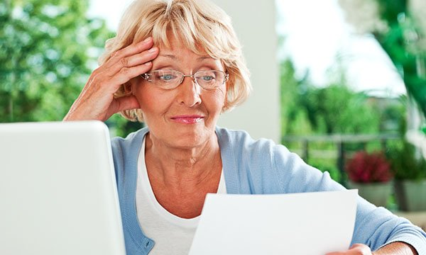 Picture shows an older woman reading a letter. The NMC has extended its appealing to those who have left in the past four or five years and those who trained overseas to join its COVID-19 temporary register.
