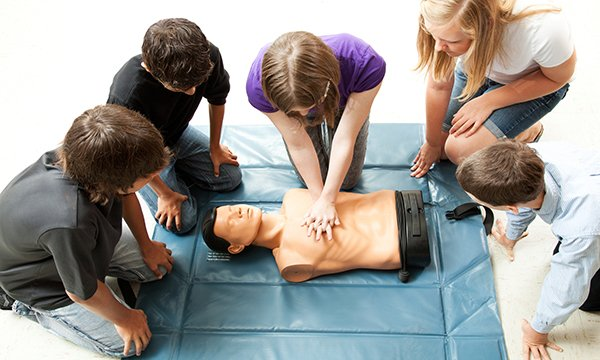 Young people practising CPR, one of the life-saving skills taught in the Street Doctors sessions