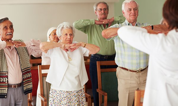 Picture shows a group of older people doing stretch exercises. Prevention of health problems among older people should be a cornerstone of geriatric medicine, and nurses have an important role to play.