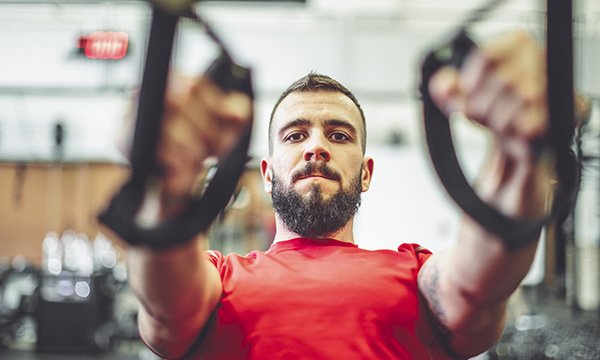 Picture shows a man exercising in a gym. The article says nurses need to learn about personal health budgets, which allow patients to use NHS funding to purchase care outside traditionally commissioned services.