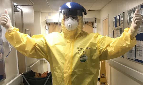 Newly qualified nurse Jesse Boxall-Steeden in full PPE in a critical care unit