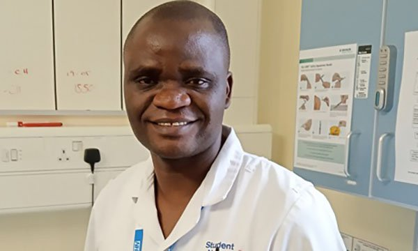 Picture of Justin Mwange, who fled conflict in his native Africa and qualified as a nurse after studying English while working in a factory. He has earned praise from his trust for overcoming adversity.