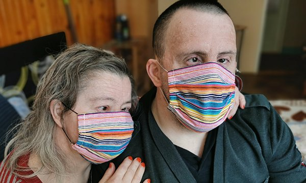 Picture shows a couple with Down's syndrome weating face masks. A nurse academic says figures on of learning disability deaths from COVID-19 are needed now to help prevent unnecessary deaths