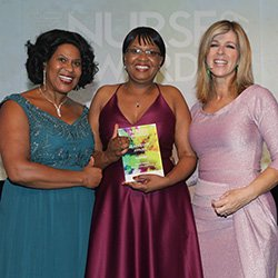 Taurai Matare receiving the Leadership award, alongside RCN deputy president Yvonne Coghill and awards host Kate Garraway