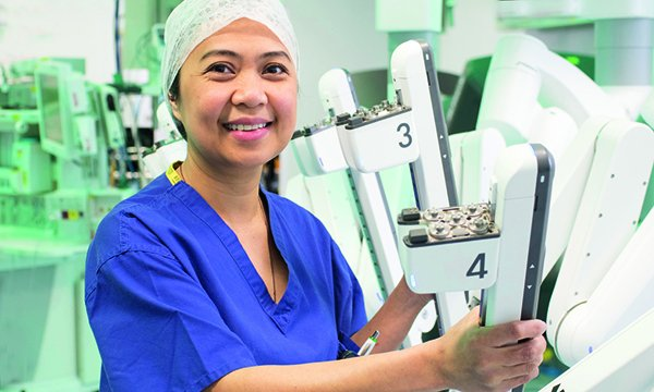 Picture shows theatre nurse Marie Taniacao with the da Vinci Xi robotic surgical system. Her course at the Royal Marsden NHS Foundation Trust will give her the skills to assist surgeons during robotic operations.
