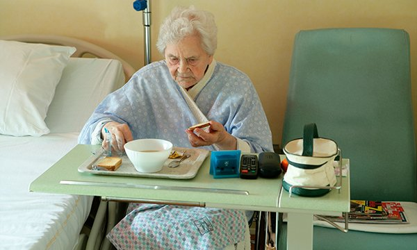 An inpatient eating at the bedside. Successful legacies of the Productive Ward programme included protected mealtimes
