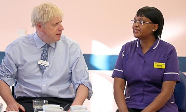 Taurai Matare, ophthalmology matron at Whipps Cross Hospital in London and RCN Nurse of the Year 2019, meets prime minister Boris Johnson
