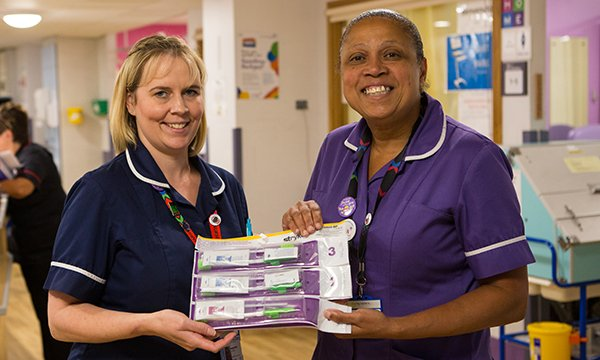 Picture shows nurses Angela Chick and Ahlam Wynne with their oral hygiene kits, which have transformed mouth care practice in their trust,  Chelsea and Westminster Hospital NHS Foundation Trust.