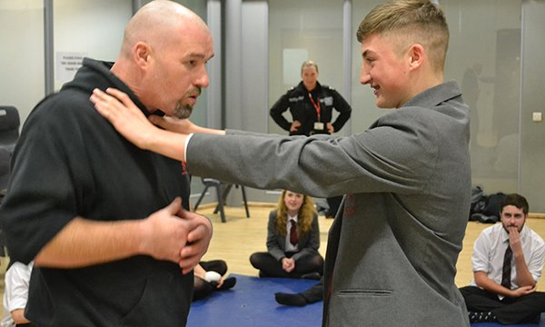 Stand Against Violence charity training session teaching self-defence to young people