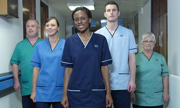 he Scottish national nursing uniform uses different shades of blue to differentiate between roles