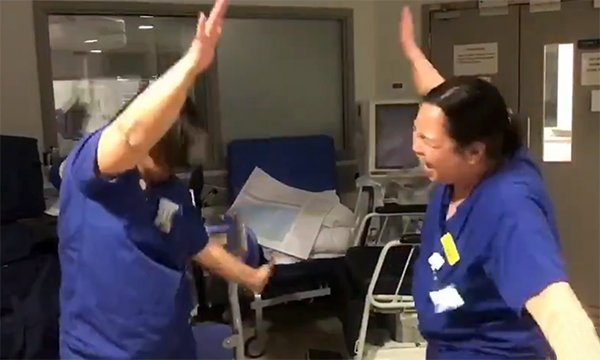 Intensive care nurses at a London hospital greet each other with a special dance, amid the coronavirus pandemic