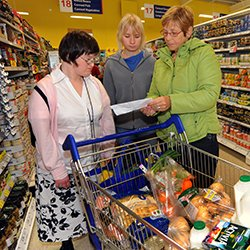 Two young women with learning disabilities shopping with a support worker in Skipton, North Yorkshire. The RCN says learning disability nurse numbers fell 17% in 2014-18.