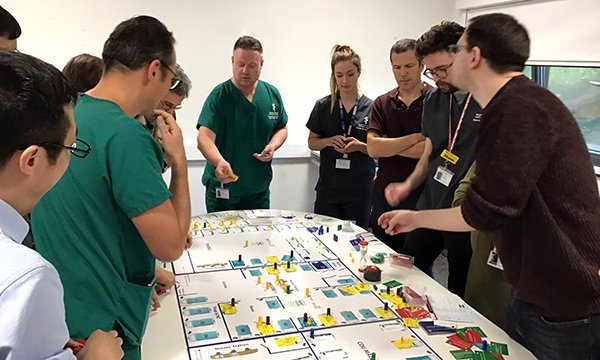 Picture of healthcare professionals taking part in The Floor game, which simulates the challenges of an emergency department and is helping nurses to develop clinical leadership skills.