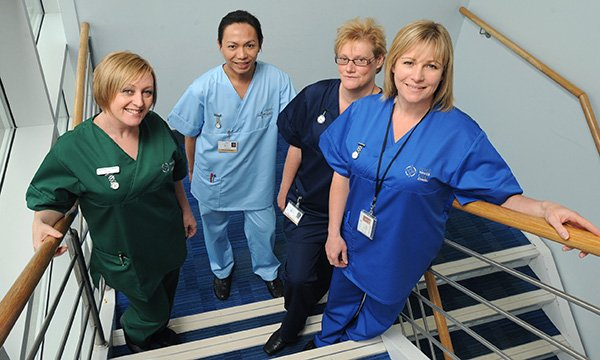 In Wales, different coloured uniforms are used to identify different nursing roles