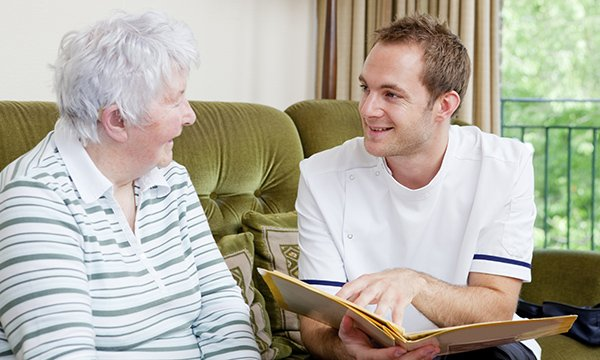 A nurse discusses a care plan with an older woman